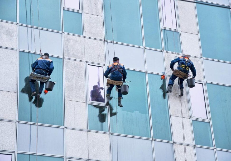 Our cleaners cleaning the commercial window